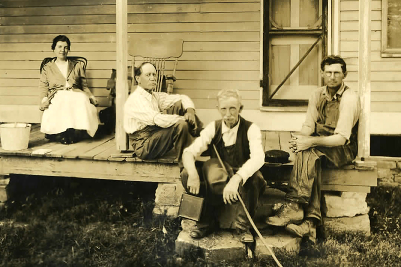 Laura Ingalls Wilder, Almanzo Wilder with neighbors on their front porch.