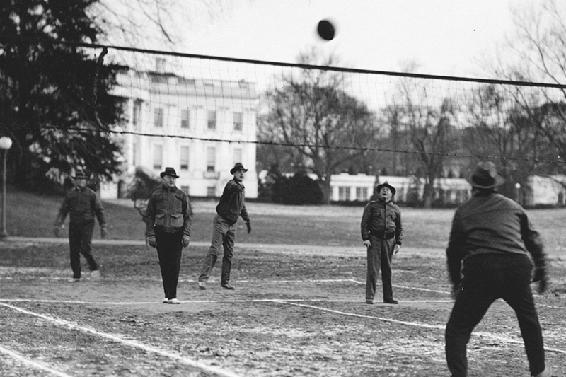 President Hoover playing a game of Hoover-Ball on the White House lawn.
