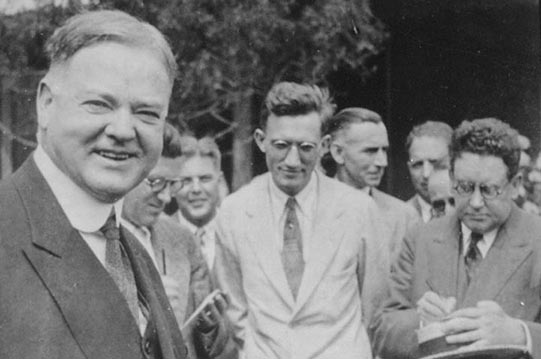Secretary Herbert Hoover with members of the press, 1928.