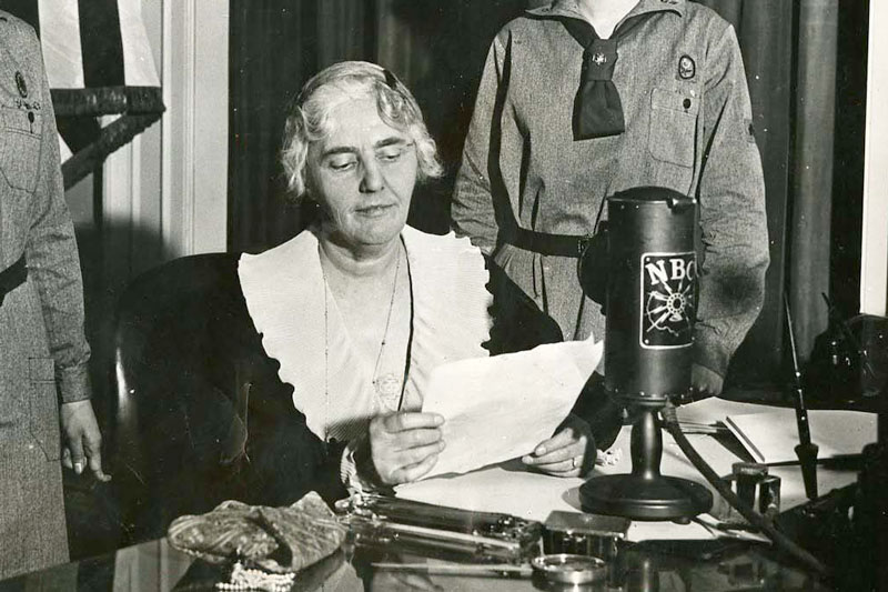 Lou Henry hoover speaking from the President's study in the White House on a special Girl Scout program. 03/24/1931. 31-1931-35
